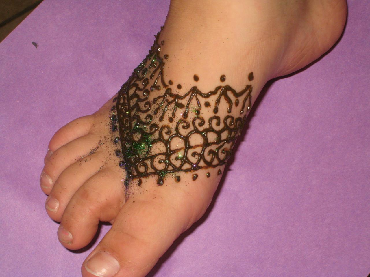 Henna tattoos designs ideas and meaning tattoos for you for Tattoo ideas for foot