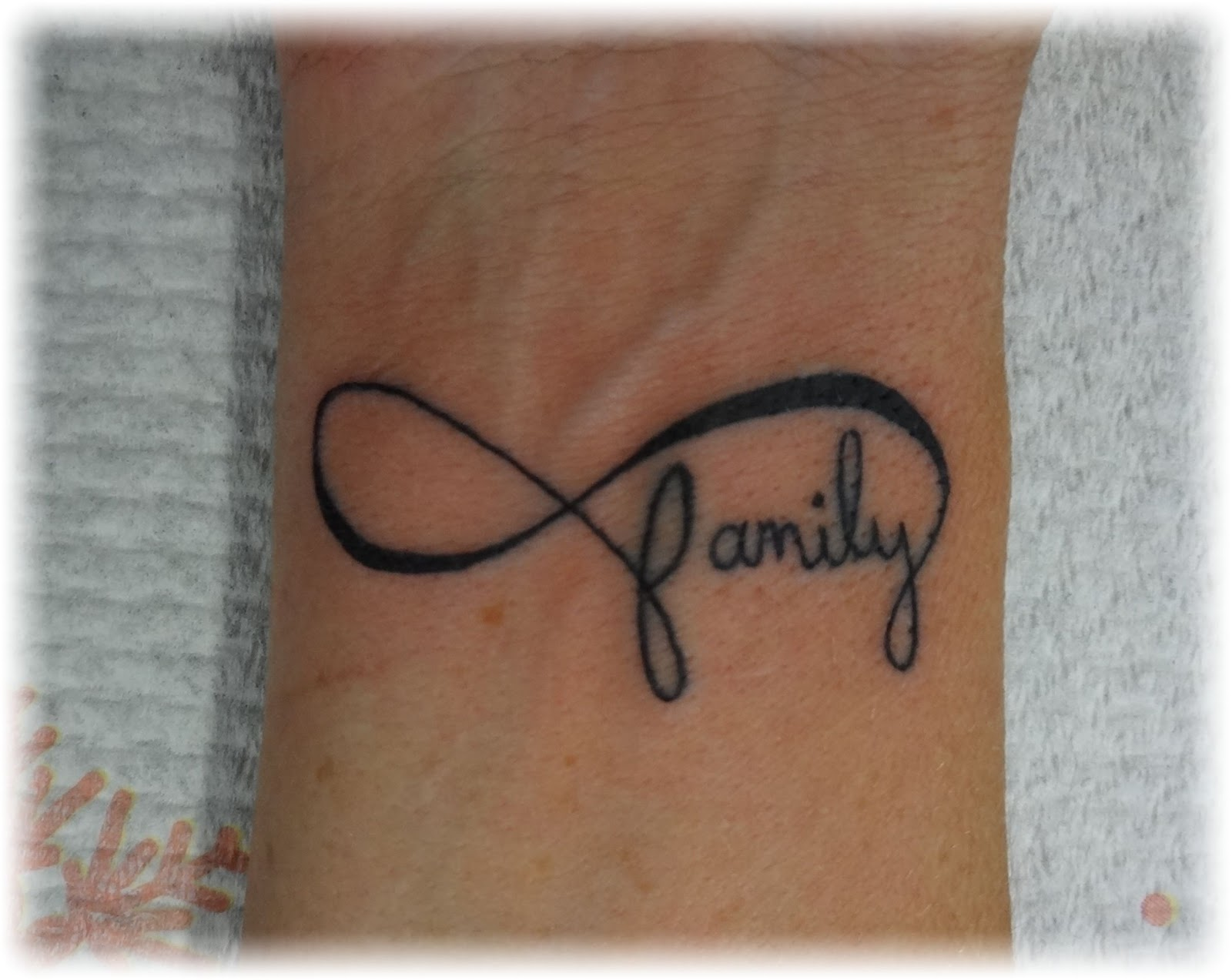 Infinity symbol tattoo on wrist meaning gallery symbols and meanings infinity tattoos designs ideas and meaning tattoos for you infinity family tattoo biocorpaavc buycottarizona Images
