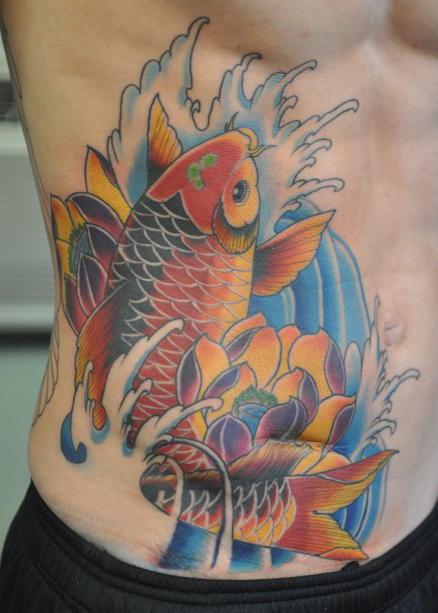 Koi Fish And Lotus Flower Tattoo