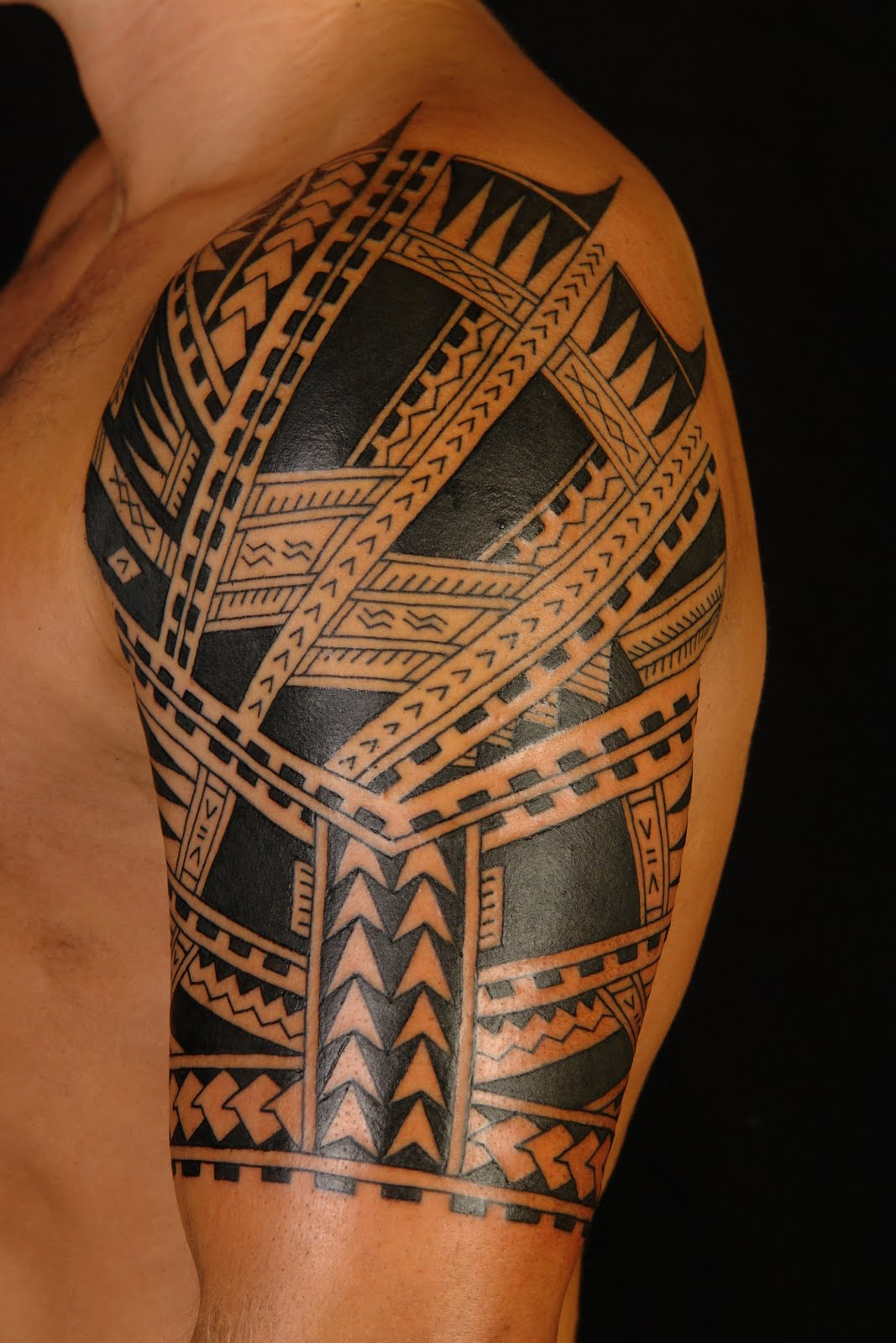 Polynesian tattoos designs ideas and meaning tattoos for Tribal half sleeve tattoos