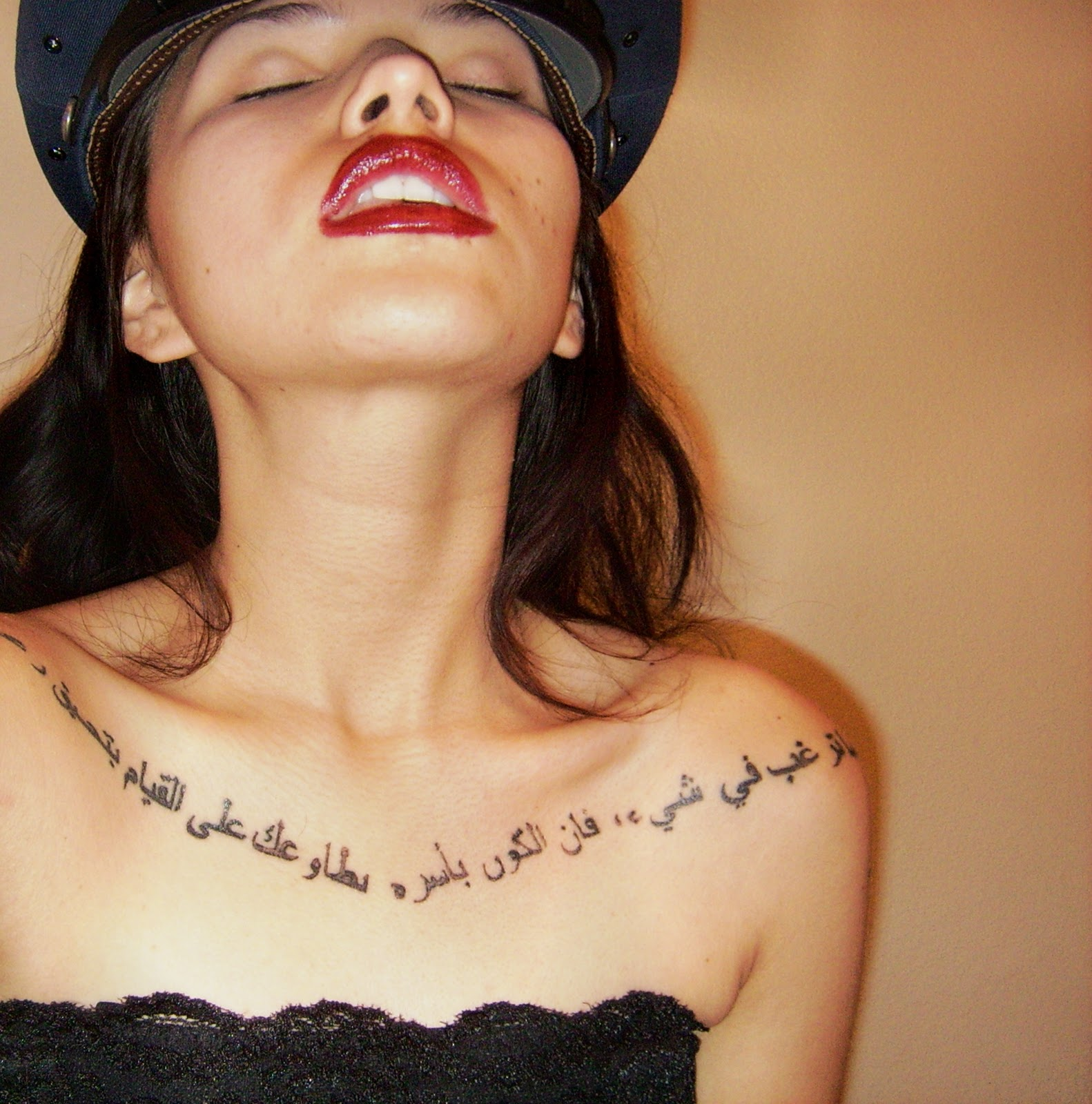 Arabic tattoo on rib cage