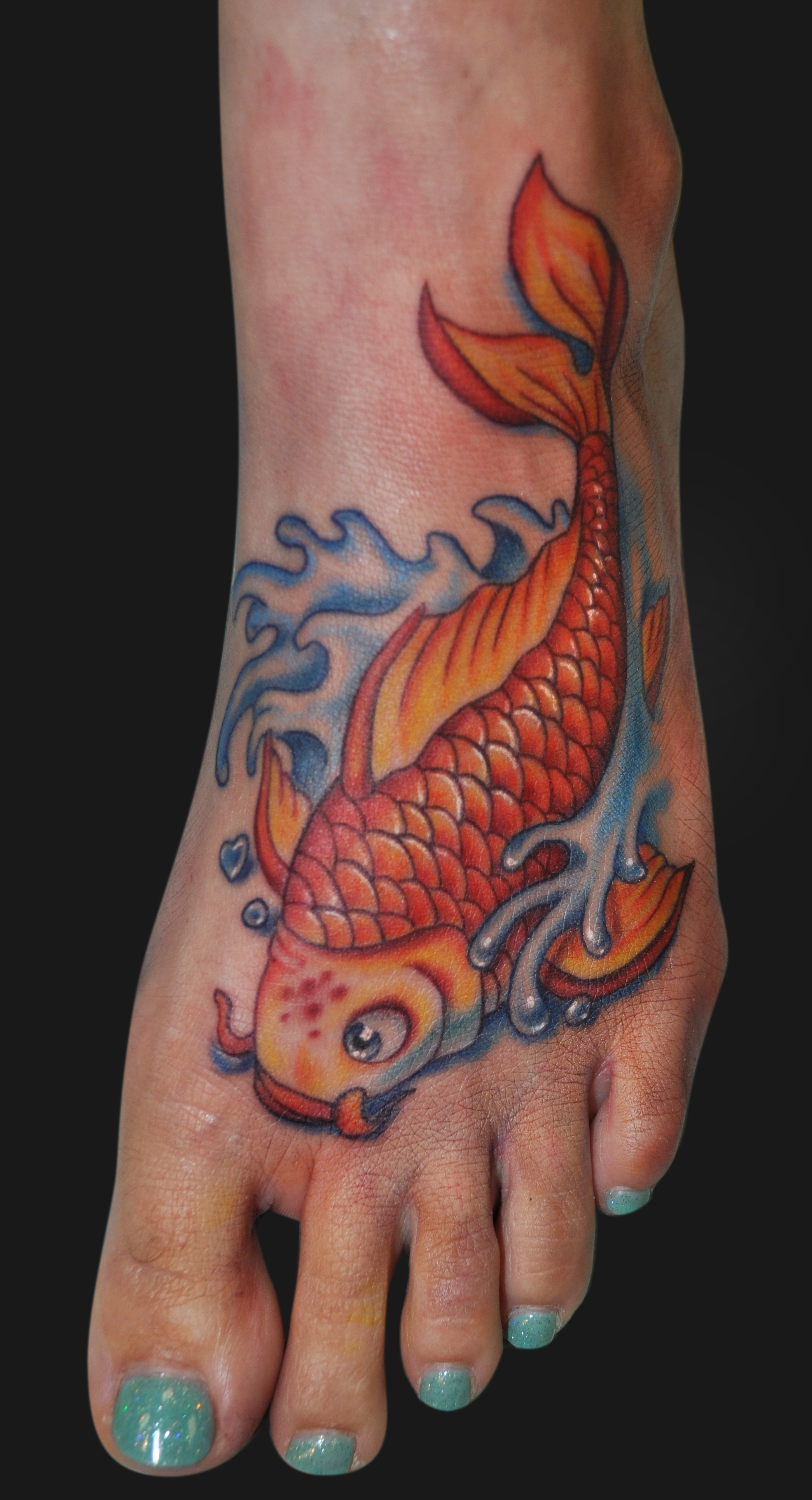 Fish tattoos designs ideas and meaning tattoos for you for Tattoo on the foot
