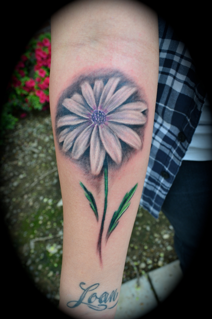 Daisy tattoos designs ideas and meaning tattoos for you daisy flower tattoo izmirmasajfo Image collections