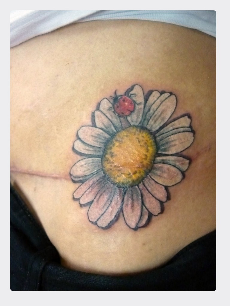 Daisy flower tattoo meaning these flowers have often been associated in christian art and literature with the qualities of innocence and purity daisy tattoos can come in a variety of izmirmasajfo Image collections