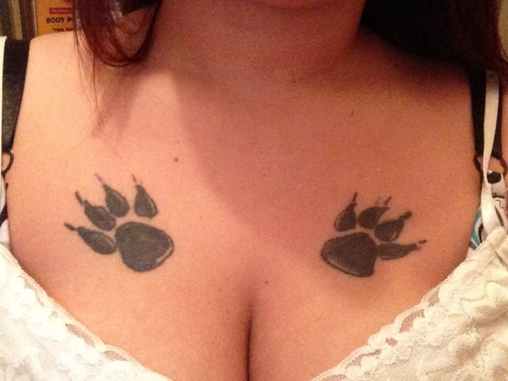Paw Print Tattoo On Chest