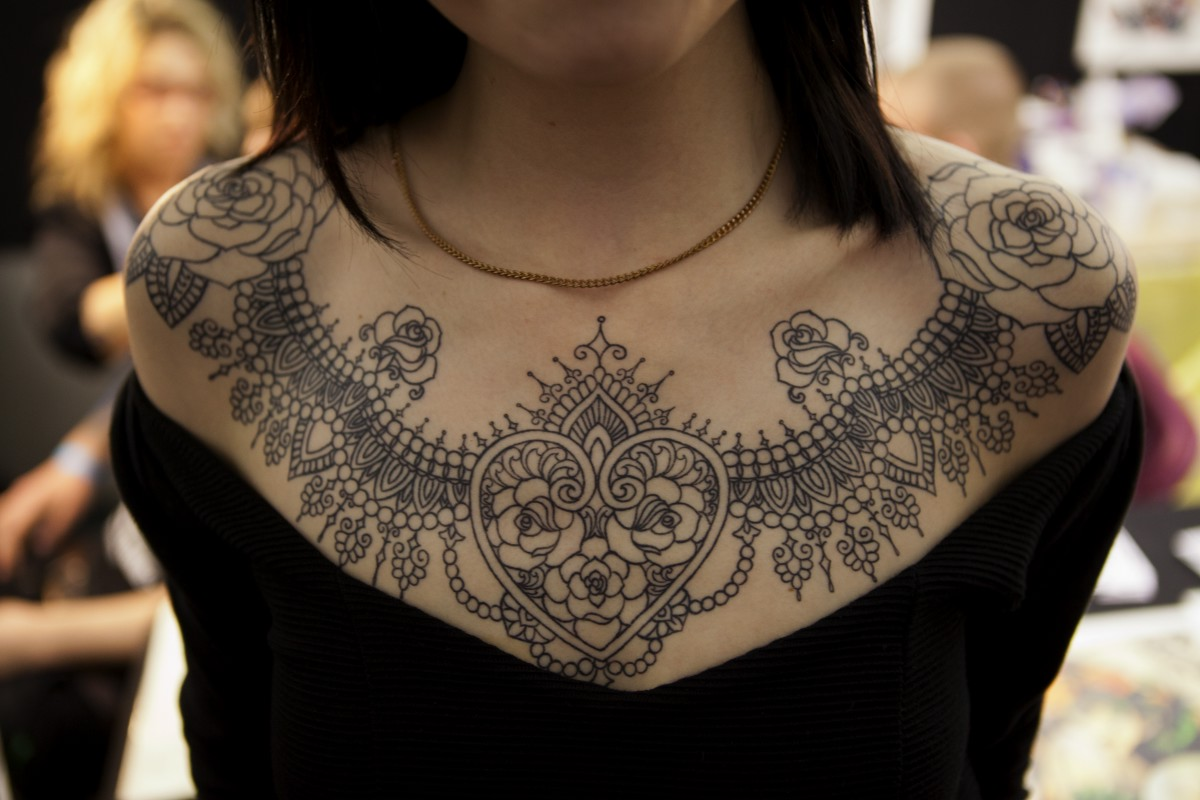 Lace tattoos designs ideas and meaning tattoos for you for Chest tattoos for women designs