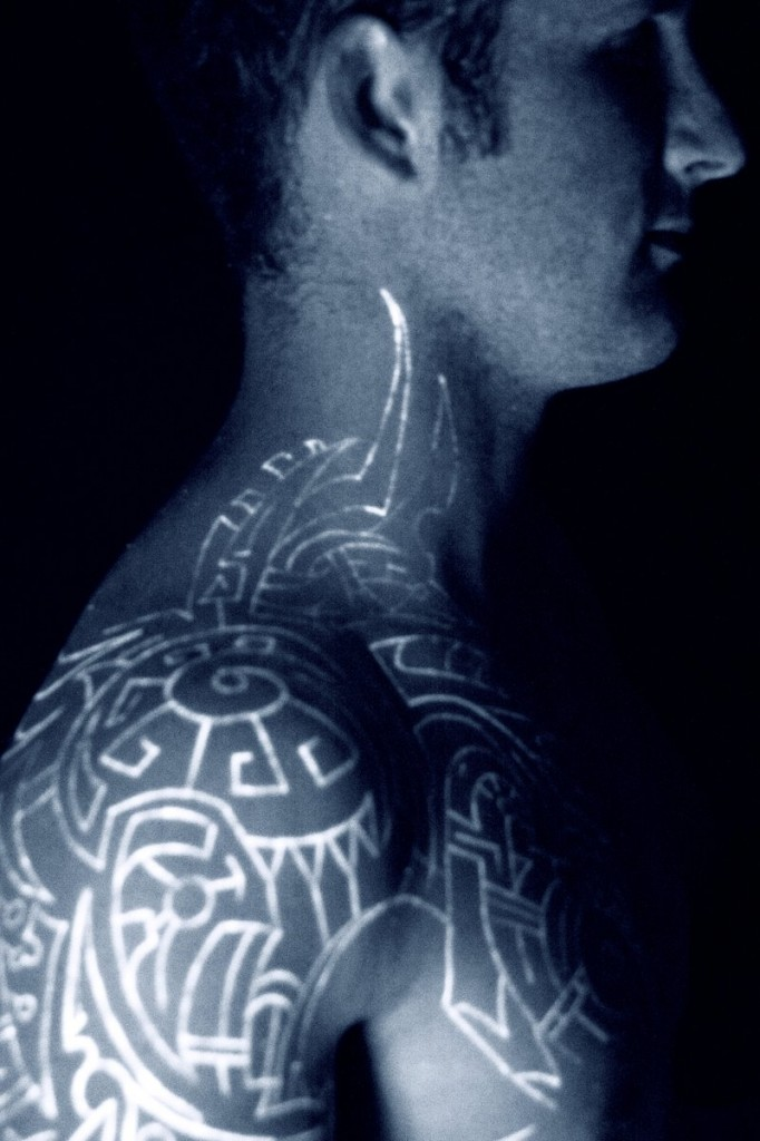 Black light tattoos designs ideas and meaning tattoos for Black tribal tattoo ink