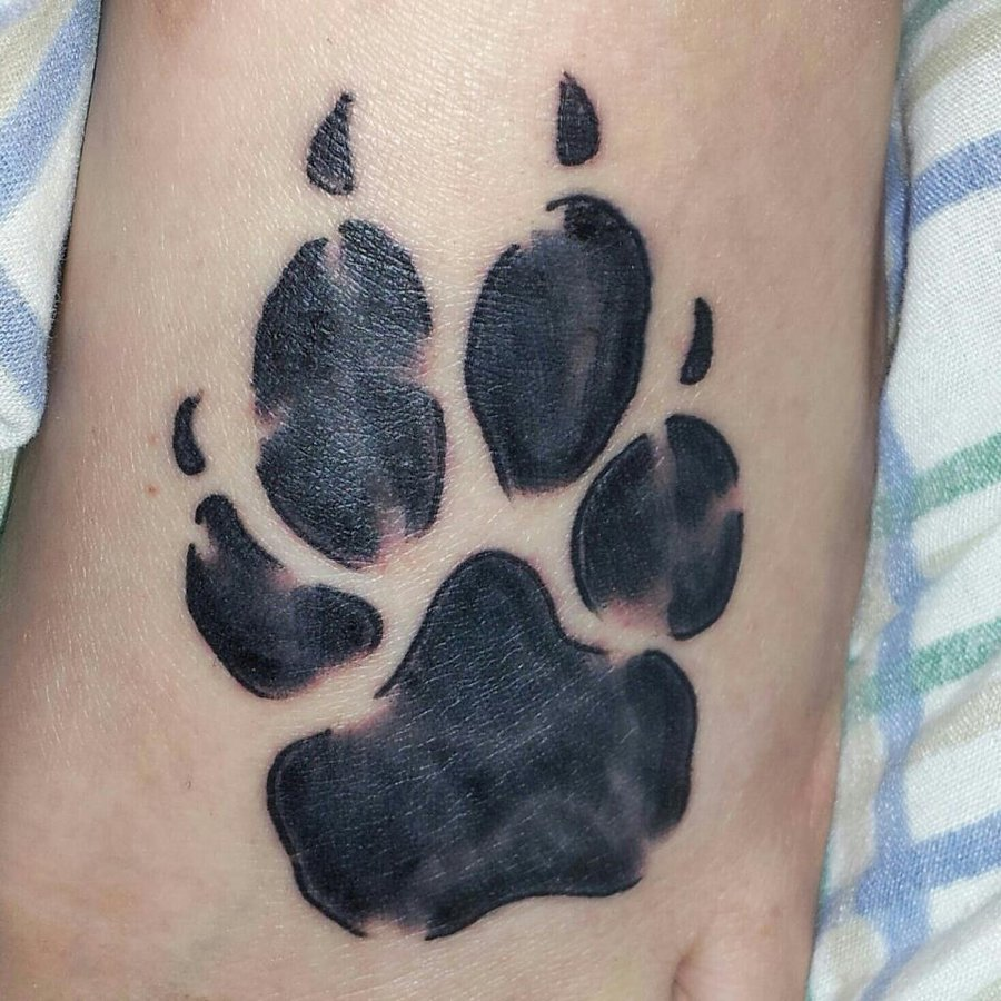 Dog paws tattoo meaning tattoos of dog paws