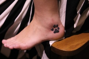 Dog Paw Print Tattoo on Ankle