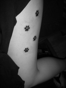 Dog Paw Print Tattoo on Thigh