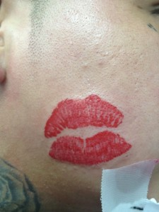 Kiss Face Tattoo