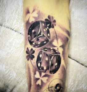 Rolling Dice Tattoo