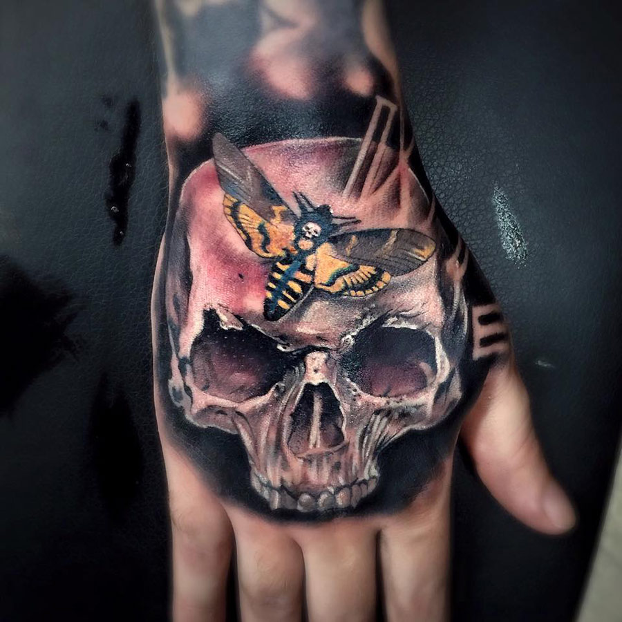 skull hand tattoos designs ideas and meaning tattoos for you. Black Bedroom Furniture Sets. Home Design Ideas