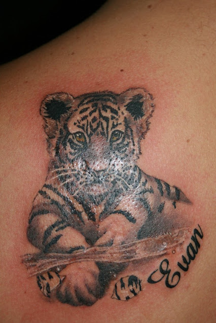 White tiger tattoos designs ideas and meaning tattoos for Small tiger tattoos