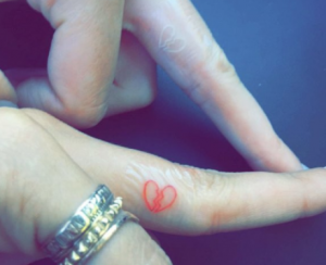 Broken Heart Tattoo on Ring Finger
