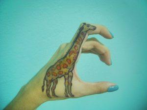 Giraffe Hand Tattoo