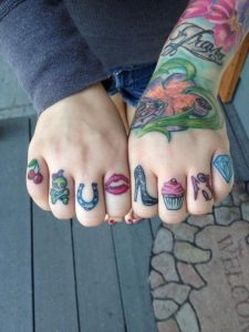 Girly Knuckle Tattoos