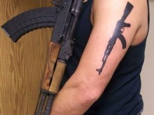 Gun Tattoos on Arm