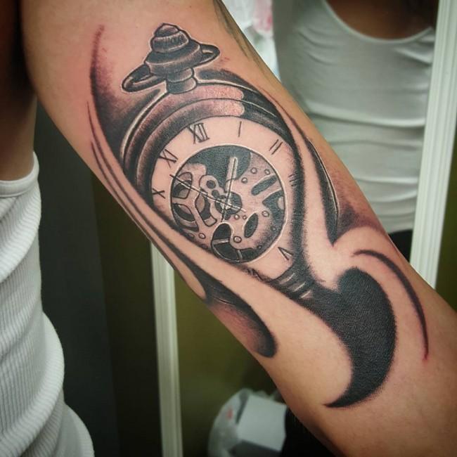 Name tattoo on bicep