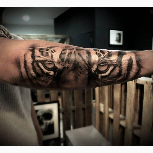 Tiger Eyes Tattoo Forearm
