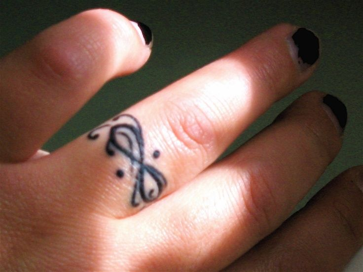 infinity tattoo on finger designs ideas and meaning. Black Bedroom Furniture Sets. Home Design Ideas