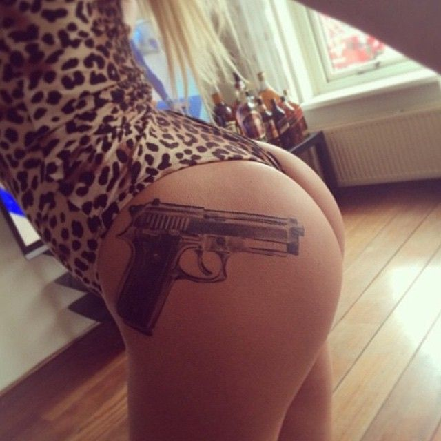 Gun thigh tattoos designs ideas and meaning tattoos for you for Gun tattoos for girls