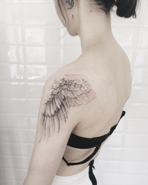 Wings tattoo on back female