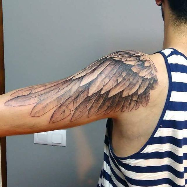 Wing tattoo on shoulder designs ideas and meaning for Wing forearm tattoo